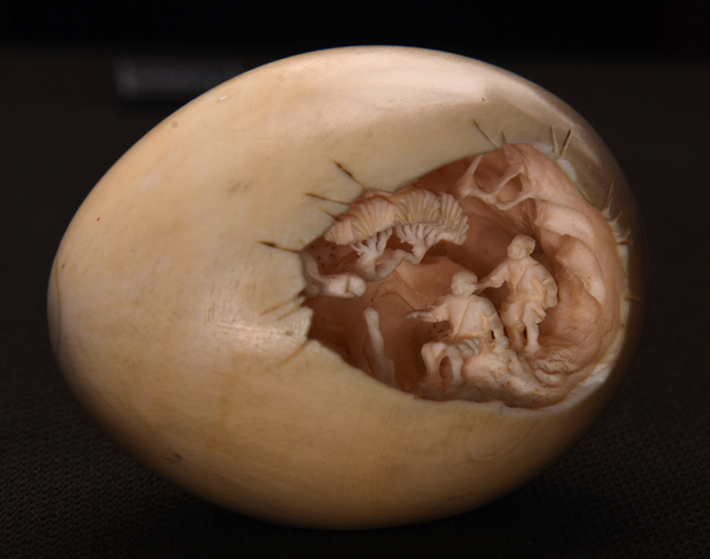 carved egg left