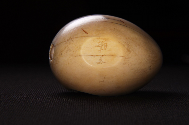 carved egg signature